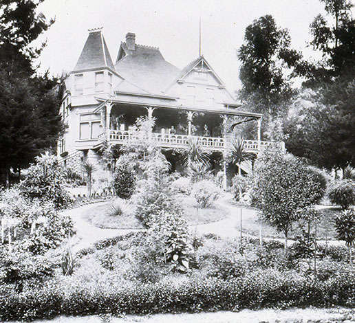 Historic J. Schram Victorian house with formal front gardens, circa 1875