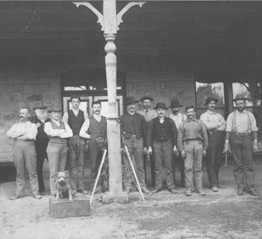 Schramsberg workers and dog gathered under the Victorian house verandah, circa 1881