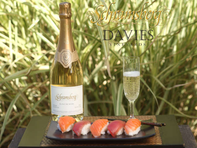 Schramsberg Blancs de Noirs sparkling wine on table with plate of sashimi
