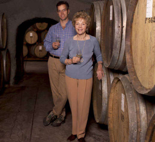 Hugh Davies and his mother, Schramsberg matriarch Jamie Davies, pose in front of wine barrels at the winery in 2005