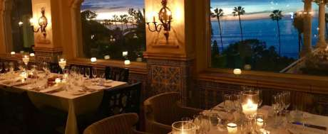 Dining table y candle light and ocean view at The Med restaurant