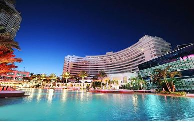 Exterior of the hotel and pool at The Fontainebleau in Miami Beach, Florida
