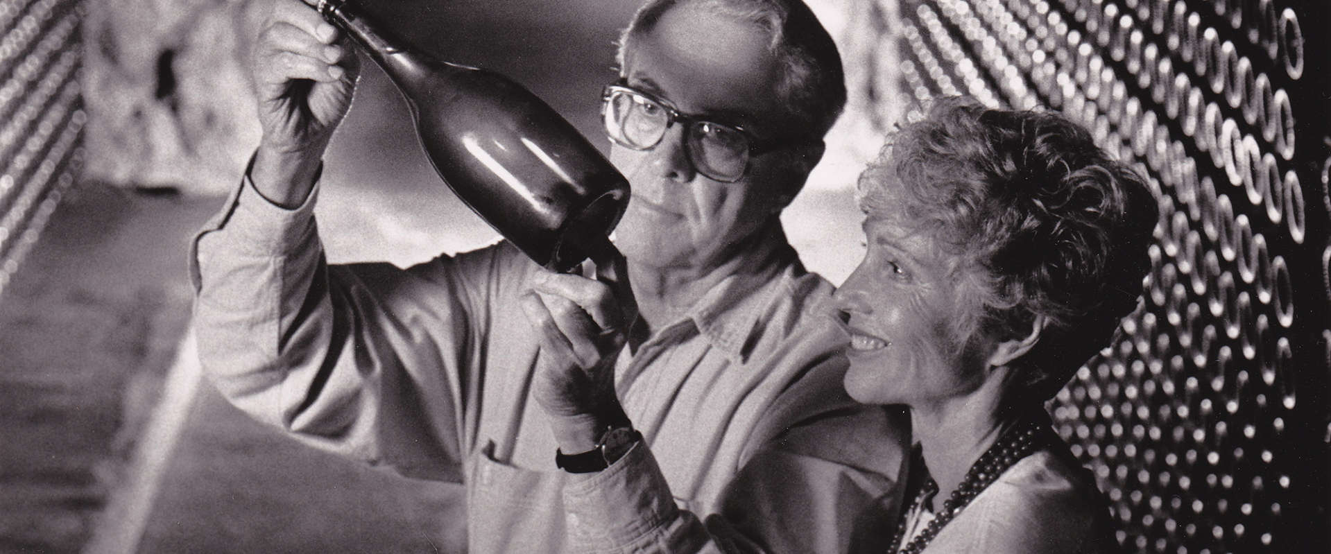 Jack and Jamie Davies inspect a bottle of sparkling wine in Schramsberg's historic wine caves circa 1980