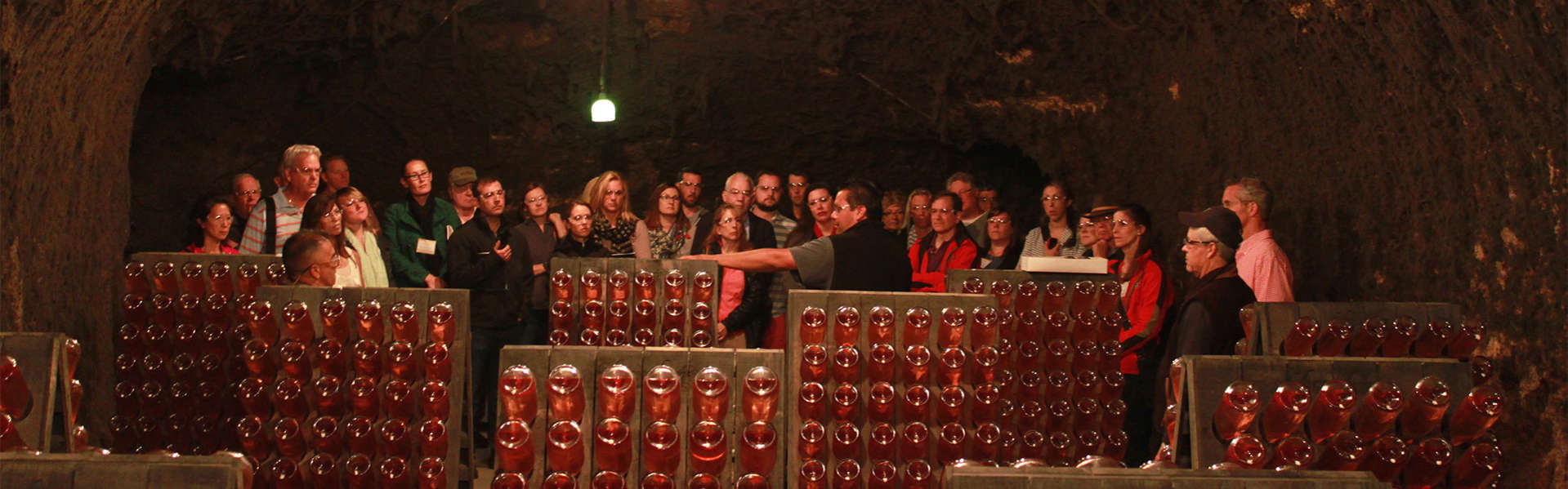 Group from Camp Schramsberg watching a riddling demonstration in the wine caves