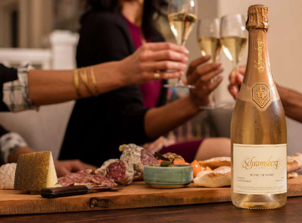 Schramsberg Blanc de Noirs toast paired with a charcuterie board