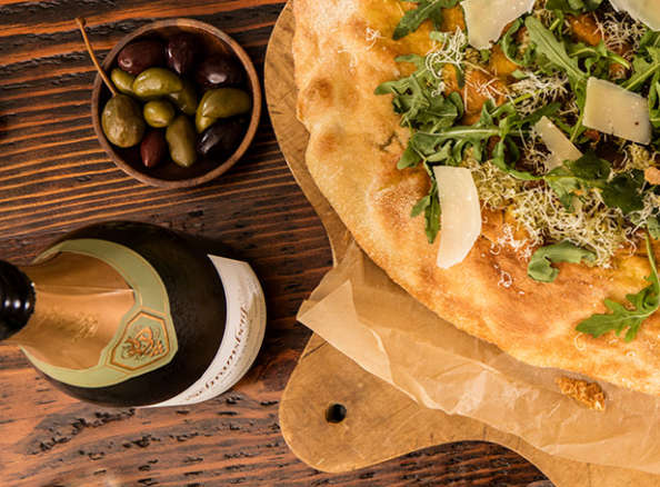 Schramsberg Blanc de Blanc sparkling wine paired with Greek olives and arugula and Parmesan flatbread