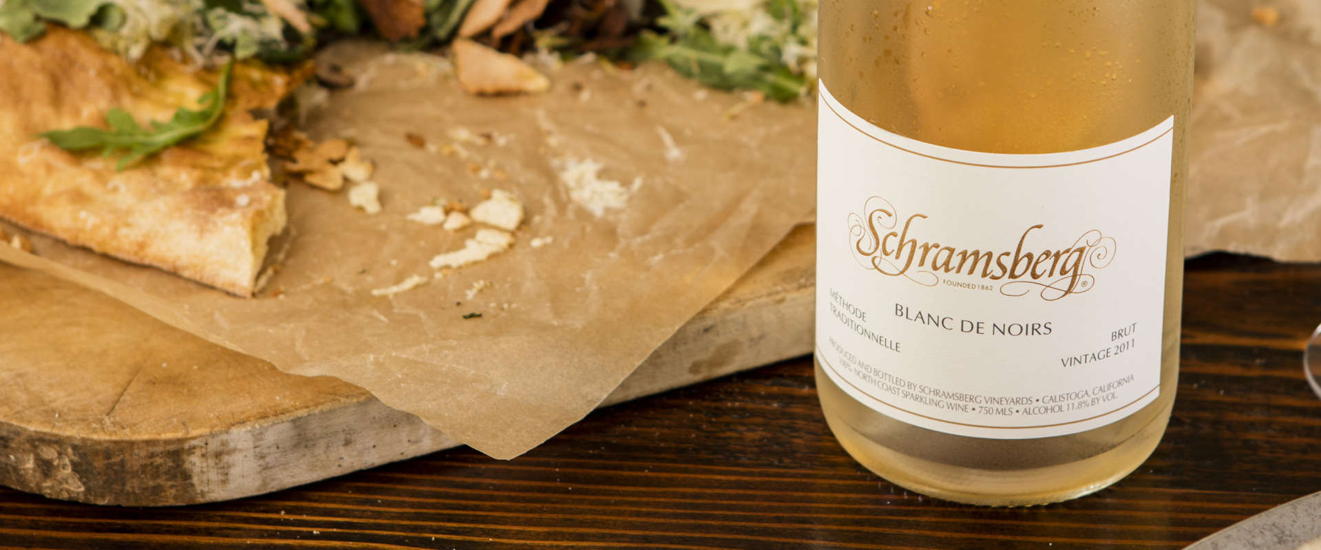 Schramsberg Blanc de Noirs sparkling wine paired with arugula and Parmesan flatbread
