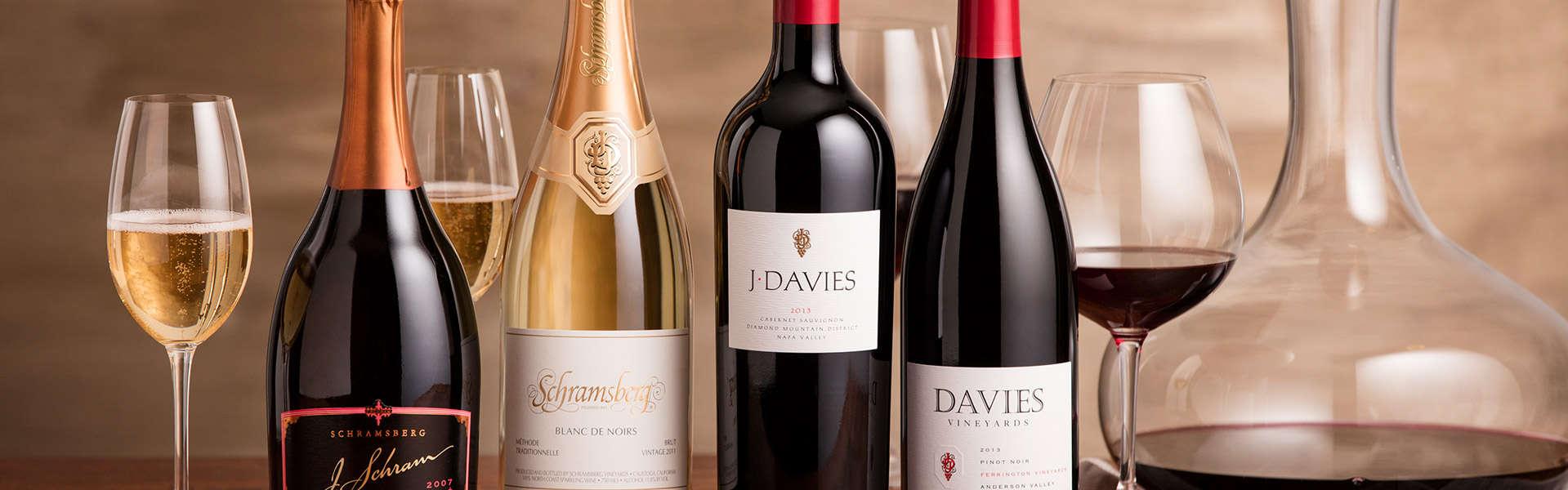 Display of J. Schram Rosé, Blanc de Noirs, J. Davies Estate Cabernet Sauvignon and Davies Vineyards Pinot Noir with glasses and wine carafe