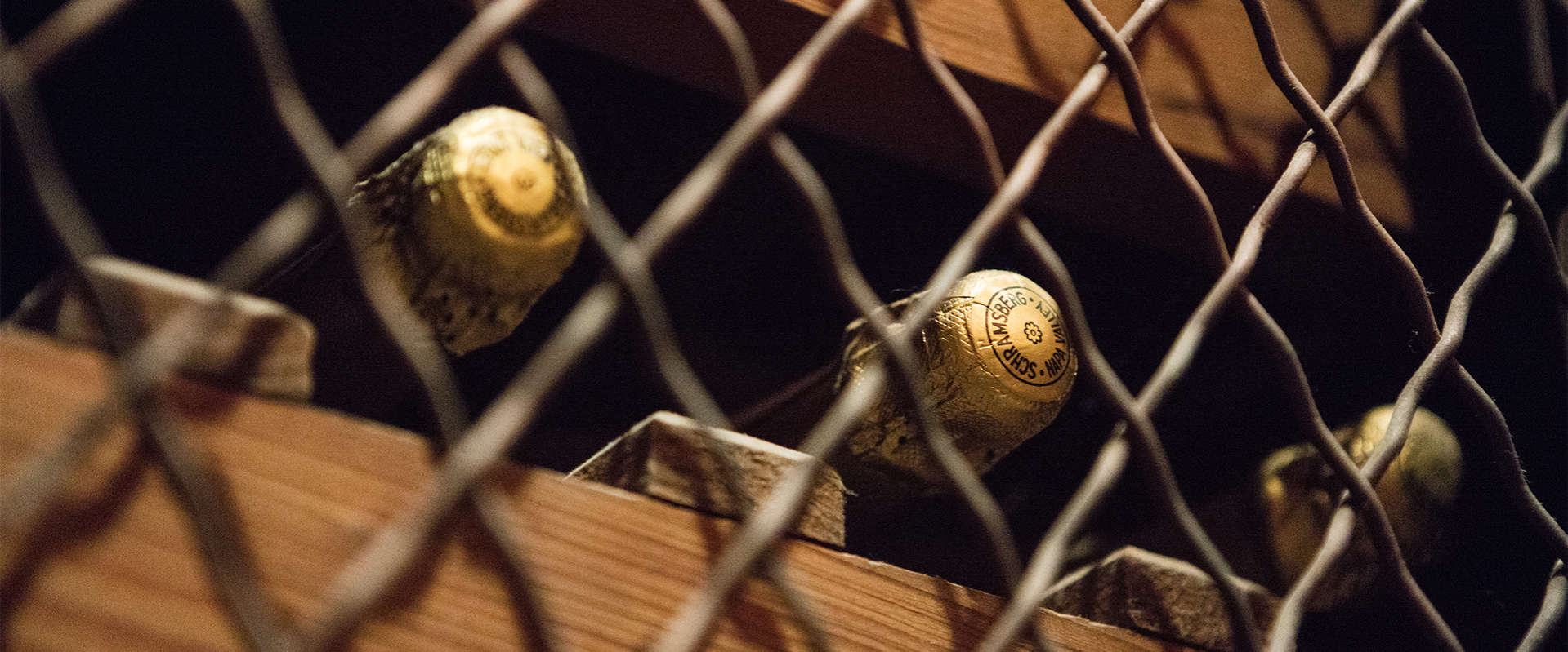 Schramsberg sparkling wine stored on wine racks in the Davies room at visitors center