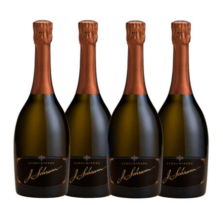 Four bottles of J. Schram sparkling wine