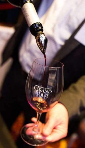 Red wine being poured into a Wine Spectator Grand Tour wine glass