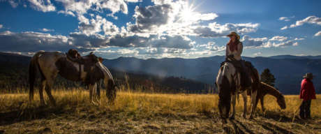 Woman on horseback in the mountains of Montana