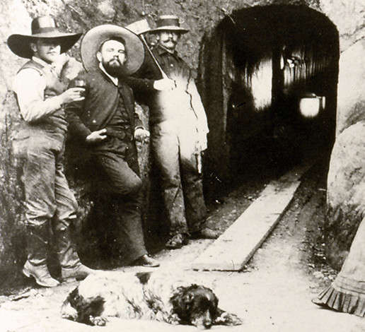 Three cellar workers standing in front of the Schramsberg wine caves entrance, circa 1870